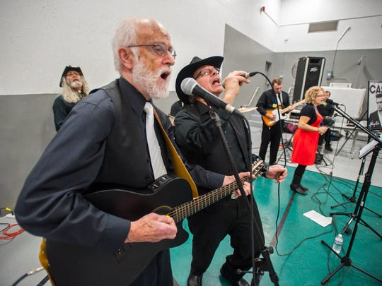 Marty Morrissey, left, and George Richard sing as the Johnny Cash Tribute Show performs at the Marble Valley Regional Correctional Facility in Rutland on Wednesday, November 30, 2016.