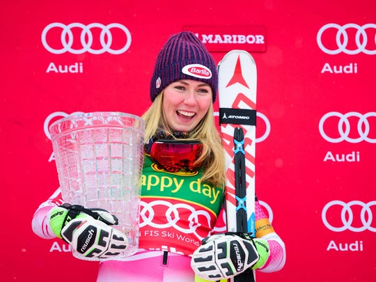 Mikaela Shiffrin holds the trophy on the podium of