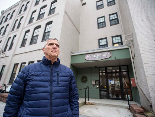 Burlington City Councilor Dave Hartnett seen in front of the South Square apartment building in Burlington on Monday, January 9, 2017.