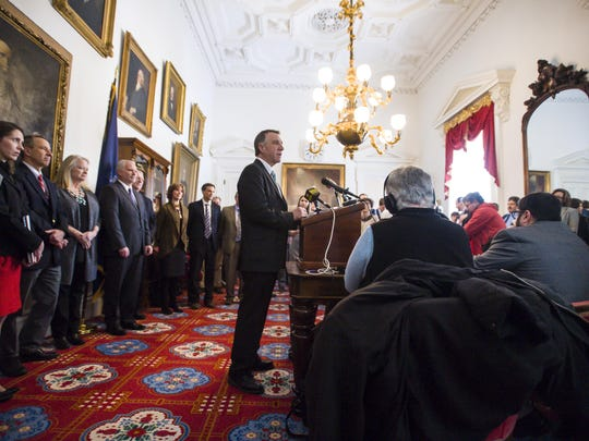 Gov. Phil Scott presents a health care reform initiative during a news conference at the Statehouse in Montpelier on Wednesday, February 8, 2017.