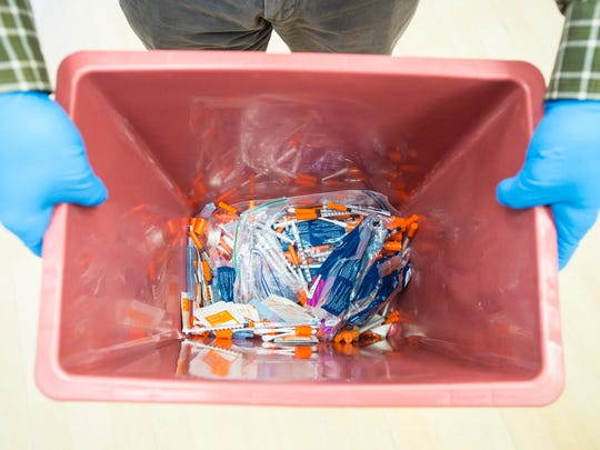 Used needles collected at the Howard Center's Safe Recovery Support and Education Program are seen in Burlington on Wednesday, March 22, 2017.