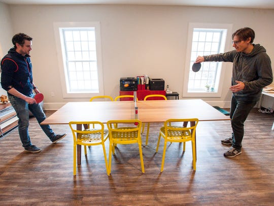 Chris Little, left, and Oliver Sweatman play ping pong in the offices of Ursa Major in Waterbury on Monday, March 27, 2017.