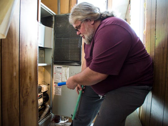 Todd Alexander of Milton, seen on Tuesday, March 28, 2017, has been on the waiting list to have his home weatherized for three years.  He hopes to to get his old kerosene furnace, which he installed 18 years ago, replaced with an energy-efficient unit.