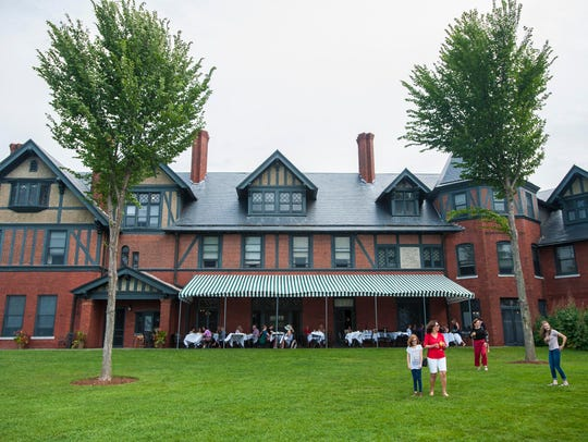 Diners enjoy the patio and the grounds at The Inn at