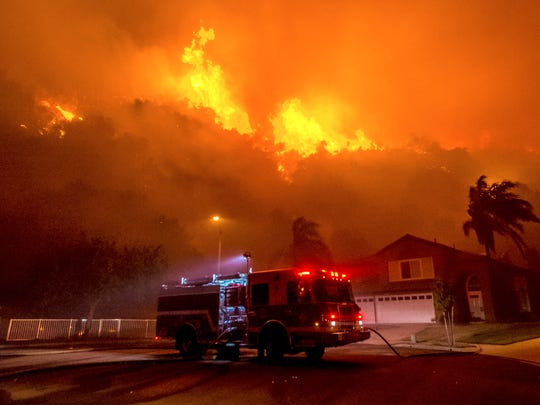 Firefighters battle to save homes as a blaze continues