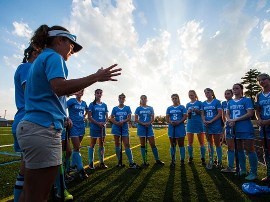 South Burlington field hockey coach Anjie Soucy speaks to her players before the start of their match against Mt. Mansfield in South Burlington on Wednesday, September 27, 2017.