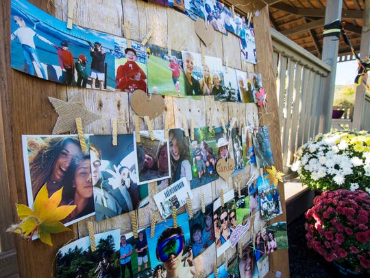 Pictures of five high school students killed in a crash one year ago are seen at a gazebo that was dedicated to their memory at Harwood Union High School in Duxbury on Thursday, October 5, 2017.