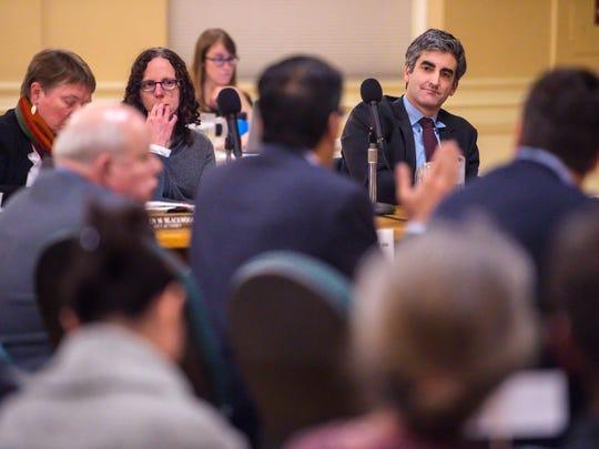 Burlington Mayor Miro Weinberger, right, listens to representatives from ZRF Partners as the Burlington City Council decides on a buyer for Burlington Telecom on Monday, November 27, 2017.