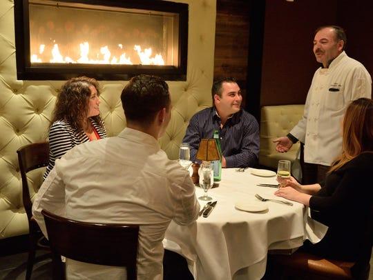 Chef Owner Sokol Geno Gjevukaj speaks with patrons