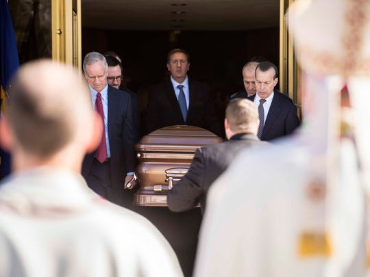 Pall bearers carry the casket holding Antonio Pomerleau out of the Chapel of St. Michael Archangel after funeral services for the developer and philanthropist at St. Michael's College in Colchester on Tuesday, February 13, 2018.