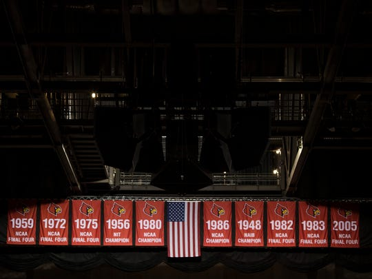 Banners hang inside the KFC Yum! Center on Tuesday after the 2013 NCAA men's basketball championship banner was removed. Feb. 20, 2018
