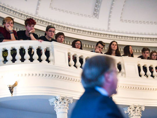 High school students listen as Sen. Phil Baruth, D-Chittenden, bottom right, speaks in favor of a measure requiring universal background checks for all gun sales in Vermont at the Statehouse in Montpelier on Thursday, March 1, 2018.