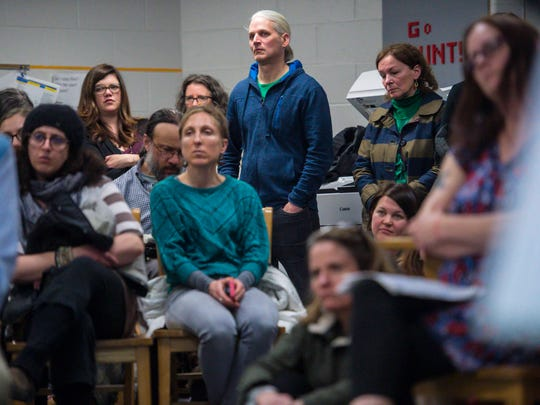 Members of the audience listen during the public comment portion of the first meeting of the newly-constituted Burlington School Board on Tuesday, April 10, 2018.