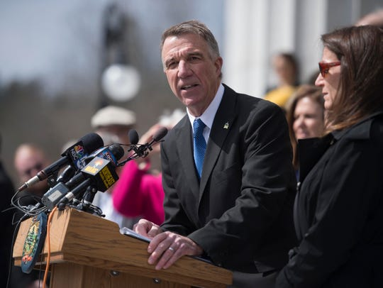 Gov. Phil Scott speaks before signing three gun reform