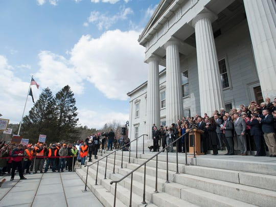 Gov. Phil Scott speaks before signing three gun reform bills on the steps of the Statehouse in Montpelier on Wednesday , April 11, 2018.