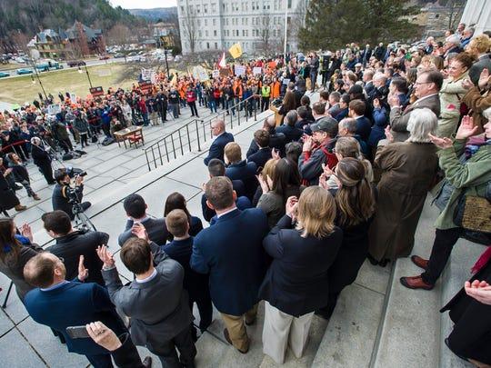 Gov. Phil Scott speaks before signing three gun reform