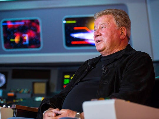 """William Shatner, who portrayed Captain James T. Kirk in the original """"Star Trek"""" TV series, answers questions on a replica of the bridge of the Starship Enterprise at Star Trek Original Set Tours in Ticonderoga N.Y. on Friday May 4, 2018."""