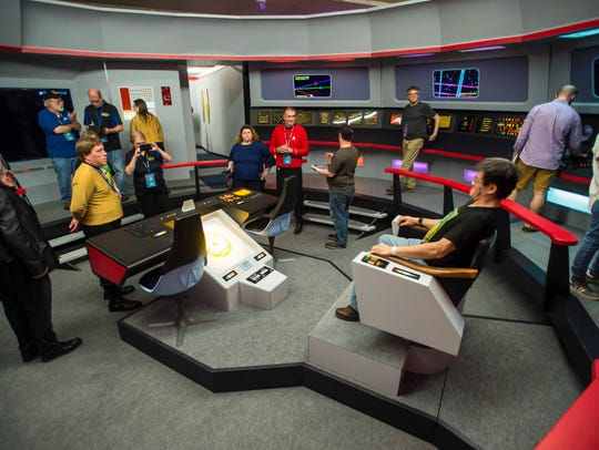 Visitors tour a replica of the bridge of the Starship