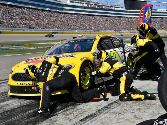 Ryan Flores, second from left, works on Ryan Blaney's car at the Pennzoil 400 in Las Vegas in March.