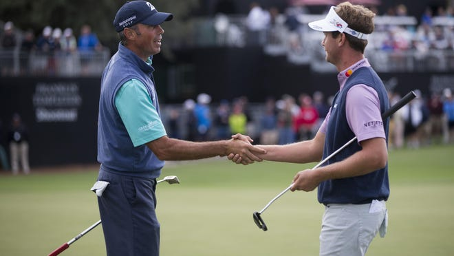 Teammates Matt Kuchar, left, and Harris English finished the second round of the Franklin Templeton Shootout in first place with a score of 21-under par.