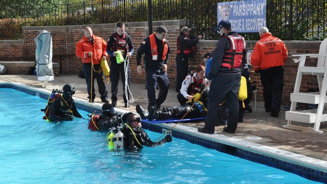 Members of the Parsippany Rescue and Recovery unit dive team stage a demonstration Sunday in the pool at the Sheraton Parsippany during the annual EMS Council of New Jersey Educational Symposium and Trade Show.