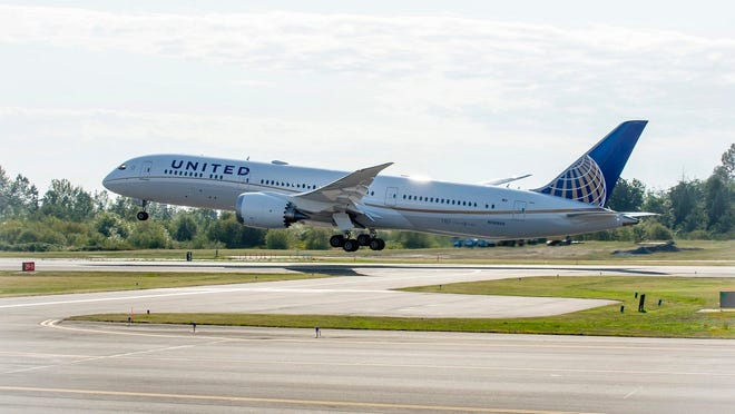 A United Airlines plane taking off.