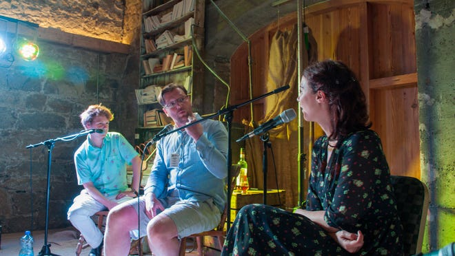 """Podcast hosts Dylan Haskins, left, and Lisa Hannigan, right, interviewing author Damien Barr, Center, on his book """"Maggie and Me."""" The interview was part of the education for UWF students as they continue their trip through Ireland."""