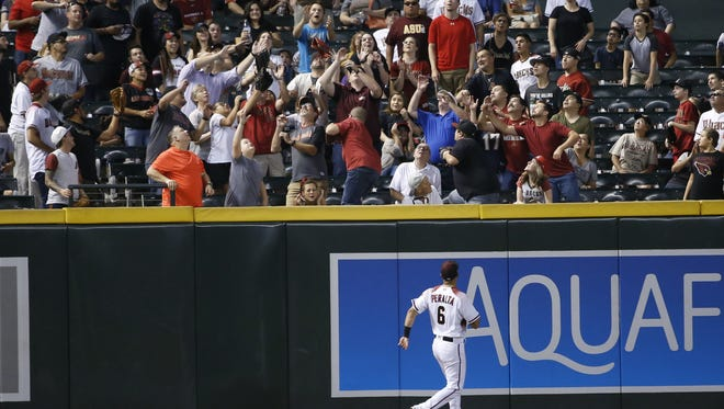 Diamondbacks David Peralta (6) watches as a home run ball from Rockies Nolan Arenado goes into the stands in the eighth inning at Chase Field in Phoenix, Ariz. on Sept 11, 2017.