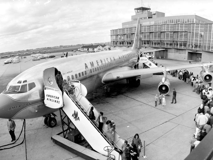 Airplane passengers board or disembark from ground-level