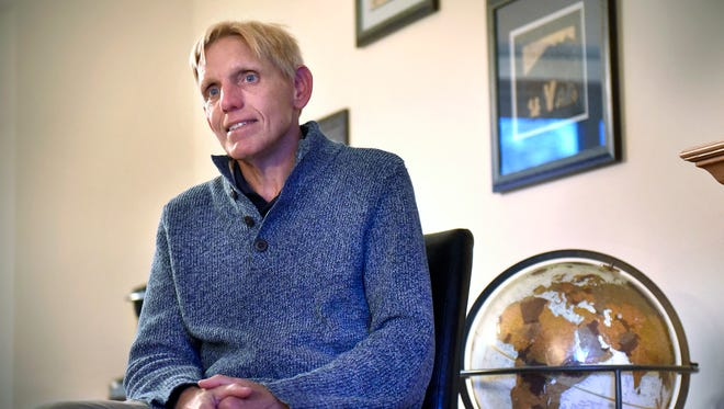 Jay Johnson talks about his road to recovery from alcoholism Wednesday, March 2, in his Sartell home. Johnson has completed marathons in all 50 states and 37 countries.