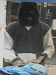 Police are looking for a masked man who robbed the Speedway gas station in the 1900 block of East Michigan Avenue Thursday morning.