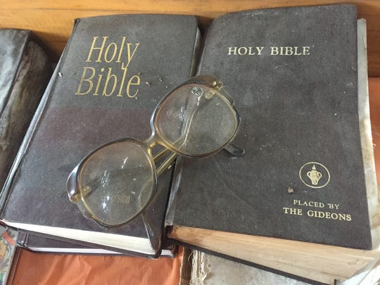 Old Bibles and reading glasses are among the church artifacts up for sale to the public.