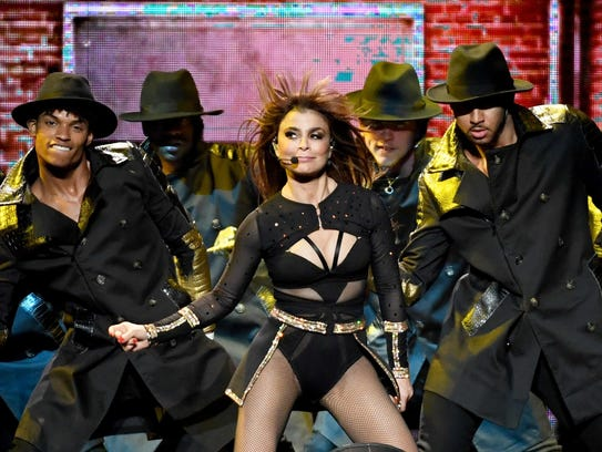 Paula Abdul, center, performs with dancers during a