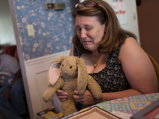 Dorothy McIntosh Shuemake cries as she hugs daughter Alison's stuffed rabbit. The 18-year-old died after a suspected heroin overdose. Some people's comments about addicts show not only heartlessness but a lack of understanding of the problem, a treatment official writes.