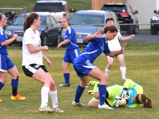 Fort Defiance goalkeeper Kelsey Cupp makes a save on