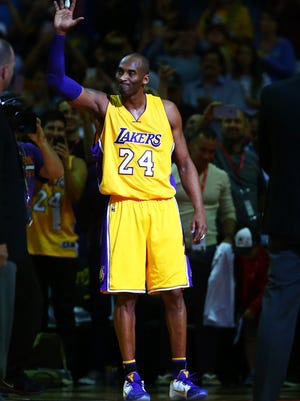 Kobe Bryant waves to the crowd during his final game in Phoenix on Wednesday night.