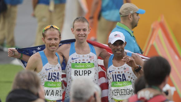 Aug 21, 2016; Rio de Janeiro, Brazil; Jared Ward (USA) , Galen Rupp (USA) and Meb Keflezighi (USA) pose for a photo after the men's marathon in the Rio 2016 Summer Olympic Games at Sambodromo. Mandatory Credit: Kirby Lee-USA TODAY Sports
