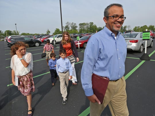 Baher Malek leads the way as he goes to church at College Park Church with his wife, Bess, and their children, Sunday, June 7, 2015.