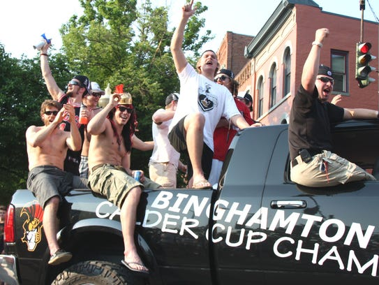 The Binghamton Senators wave to fans during the parade