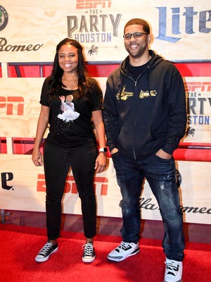 Former SportsCenter co-hosts Jemele Hill and Michael Smith pose for a photo at an ESPN party before this year's Super Bowl in Houston.