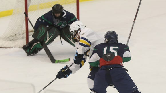 Pelham's Ben Hurd scores one of his four first-period goals against Mount Pleasant  during a Section 1 Division 2 quarterfinal at the Ice Hutch in Mount Vernon Wednesday.