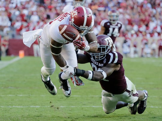 Alabama receiver ArDarius Stewart (13) dives for a pass as Texas A&M defensive back Brandon Williams (21) breaks up the play during the second half of an NCAA college football game, Saturday, Oct. 17, 2015, in College Station, Texas. Alabama won 41-23. (AP Photo/Eric Gay)