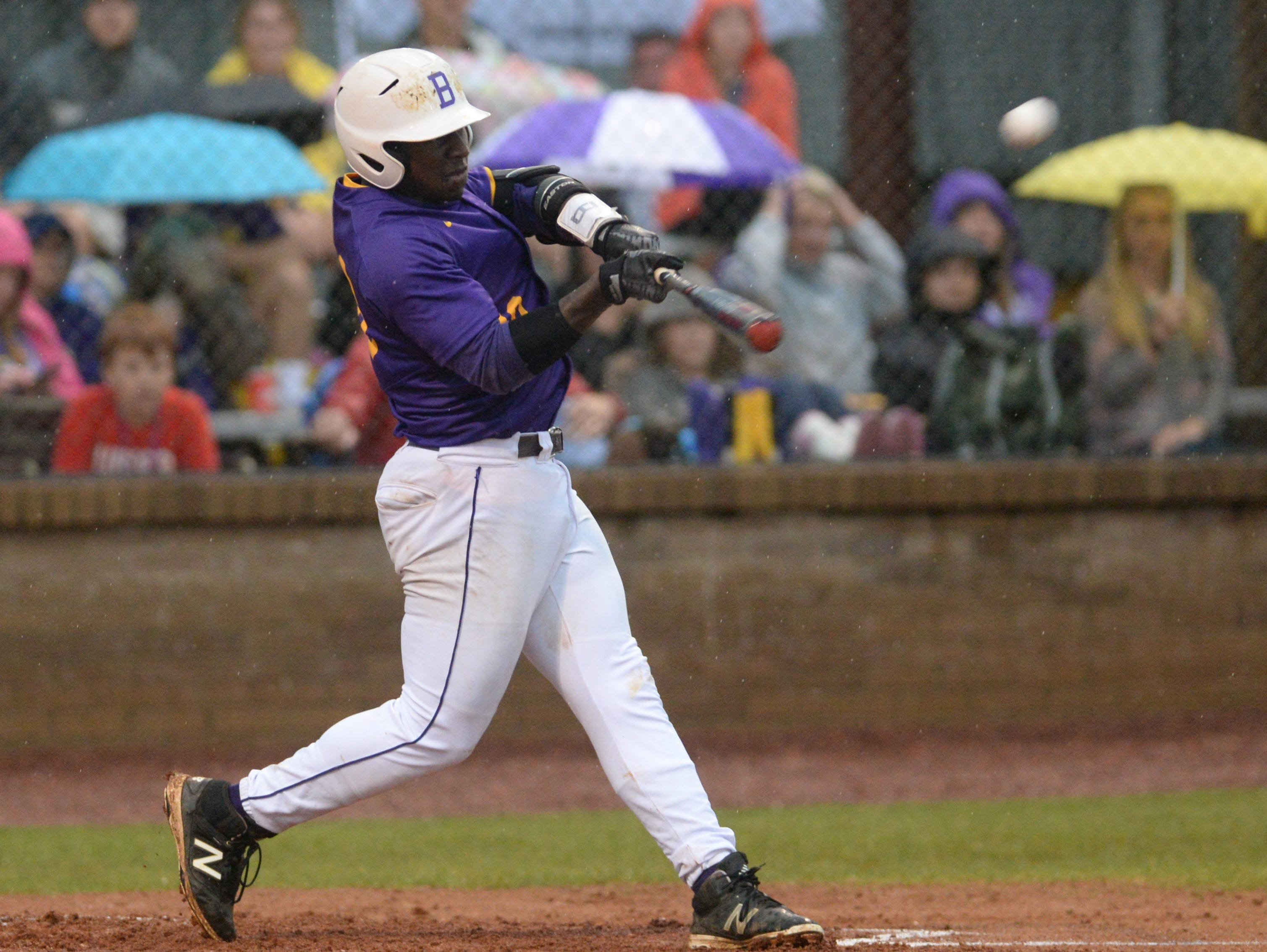 Byrd's Zavier Moore hits his first of two homeruns on the night against Capt. Shreve.