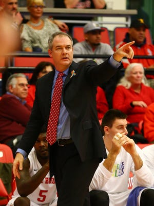 Stony Brook head coach Steve Pikiell displays a rainbow pin during the game during You Can Play night.