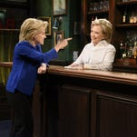 "Kate McKinnon portrays Democratic presidential candidate Hillary Clinton, left, and Clinton on ""Saturday Night Live"" in New York on Oct. 3, 2015."