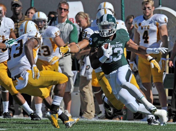 Jeremy Langford (33) reverses and confuses the Cowboys on his way to a first quarter first down as MSU hosts Wyoming Saturday at Spartan Stadium in East Lansing. The Spartans won 56-14 to go 3-1 on the season.