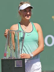 Victoria Azarenka poses with the trophy after her win over Serena Williams at the BNP Paribas Open in Indian Wells, March 20, 2016.