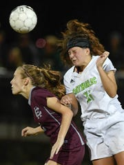 Henderson's Maddie Griggs (left) and Catholic's Isabelle Stanfield head the ball as the No. 11 Lady Colonels play No. 5 Owensboro Catholic in the semistate in Owensboro Monday, October 24, 2016.