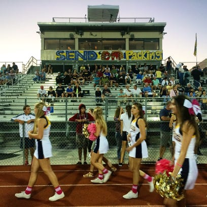 Cheerleaders arrive for the South Fort Myers at Naples