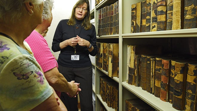 Kari Kohlhoff, curator of collections at Siouxland Heritage Museums, shows the basement archive area to participants of a behind the scenes tour of the Pettigrew Home & Museum Tuesday, July 12, 2016, at the museum in Sioux Falls.